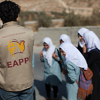 """A """"school run"""" in the West Bank: ecumenical accompaniers visit schools as the students travel to and from the schools, to protect the students from agression and intimidation from Israeli forces and settlers. The Ecumenical Accompaniment Programme in Palestine and Israel (EAPPI) is a programme coordinated by the World Council of Churches founded in response to a call from the local Heads of Churches in Jerusalem that brings internationals to the West Bank. Since 2002, over 1,500 volunteers have come for three months to be Ecumenical Accompaniers. Accompaniers offer protective presence to vulnerable communities and monitor and report human rights abuses. They join Palestinians and Israelis who work in nonviolent ways for peace and support the local churches."""