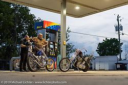 Bobby the Leg Middleton's 1948 Harley-Davidson Born Free 6 Pan-Shovel chopper (L) alongside Jeffrey Gillis Harley-Davidson Panhead chopper at a gas stop during Daytona Beach Bike Week, FL. USA. Monday, March 11, 2019. Photography ©2019 Michael Lichter.
