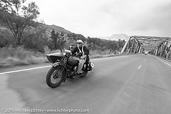 Gary Wright riding his 1930 Indian Chief with his wife Linda Bendorf in the sidecar near Grand Junction, Colorado during Stage 10 (278 miles) of the Motorcycle Cannonball Cross-Country Endurance Run, which on this day ran from Golden to Grand Junction, CO., USA. Monday, September 15, 2014.  Photography ©2014 Michael Lichter.