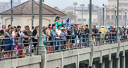 June 20, 2017 - Huntington Beach, California, USA - The Huntington Beach Pier was full of spectators as they watch 511 surfers float on their boards and hold hands in the ocean to create the world's largest paddle out ''Surfing Circle of Honor'' in Huntington Beach Tuesday morning, June  20, 2017. (Photo by Mark Rightmire, Orange County Register/SCNG) (Credit Image: © Mark Rightmire, Mark Rightmire/The Orange County Register via ZUMA Wire)