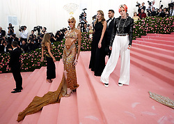 Winnie Harlow (left) and Kristen Stewart attending the Metropolitan Museum of Art Costume Institute Benefit Gala 2019 in New York, USA.