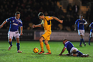 Newport's Conor Washington © shoots and scores his sides 3rd goal. Johnstone's Paint Trophy Quarter Final (Southern Area)  match, Newport county v Portsmouth at Rodney Parade in Newport, South Wales on Tuesday 12th November 2013. pic by Andrew Orchard, Andrew Orchard sports photography,