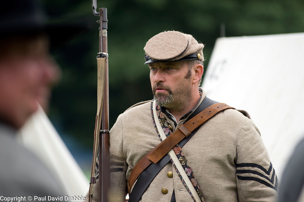 A re-enactor from the American Civil War Society portrays a Sergeant from the Confederate 43rd North Carolina 'B' company Daniel's during a multi period event at Norfolk Heritage Park Sheffield 29th and 30th Aug 2010 .Images © Paul David Drabble..