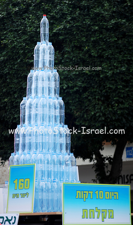 Save water display showing mineral water bottles containing 160 litres which is the amount of water used in a 10 minute shower