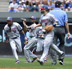 July 2, 2017 - Kansas City, MO, USA - Minnesota Twins center fielder Byron Buxton goes into a crowd of teammates to track down a fly ball out on Kansas City Royals' Whit Merrifield in the first inning on Sunday, July 2, 2017 at Kauffman Stadium in Kansas City, Mo. (Credit Image: © John Sleezer/TNS via ZUMA Wire)