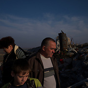 SNIZHNE, UKRAINE - OCTOBER 17, 2014: A group of civilians visit de ruins of a large monument in memory of soldiers killed during the Second World War near Snizhne. The famous monument once stood atop Savur-Mohyla, the highest ground in the Donetsk region that in the past months have been a stage of fierce fighting between the DNR separatist forces and the Ukrainian National Guard. CREDIT: Paulo Nunes dos Santos