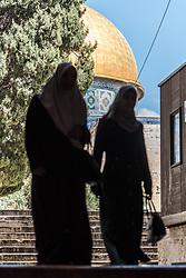 19 April 2019, Jerusalem: Two women exits the Al Aqsa mosque into the below Suq al Qattanin (the Cotton Market).