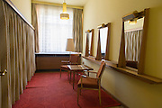 Socialist decor near the conference room where the heads of the GDR secret police met with district administrators, an exhibit in 'Haus 1' the ministerial headquarters of the Stasi secret police in Communist East Germany, the GDR. Built in 1960, the complex now known as the Stasi Museum. Before the fall of the Wall, it was a 22-hectare complex of espionage whose centrepiece is the office and working quarters of the former Minister of State Security, Erich Mielke who considered their role as the 'shield and sword of the party', conducting one of the world's most efficient spying operations against its political dissenters during its 40-year old socialist history. During Hitler's Third Reich, the Gestapo had one agent for every 2,000 citizens whereas the Stasi had approximately an spy for every 6.5. Here at the Stasi HQ alone 15,000 were employed plus the many regional stations. German media called East Germany 'the most perfected surveillance state of all time' - administered from this complex of offices.