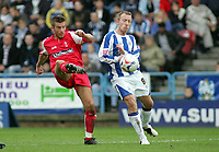 Photo: Paul Thomas.<br /> Huddersfield Town v Swindon Town. Coca Cola League 1. 29/10/2005. <br /> <br /> Swindon's Michael Pook passes the ball past Tony Carss.