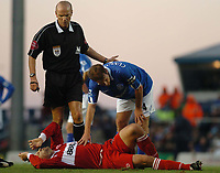 Mark Viduka (Middlesbrough) is checked by Birmingham captain Kenny Cunningham as he lies injured. Birmingham City v Middlesbrough, FA Premiership, 26/12/2004. Credit: Back Page Images / Matthew Impey