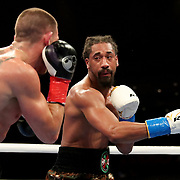 HOLLYWOOD, FL - APRIL 17:  Demetrius Andrade punches Liam Williams during the WBO Middleweight Championship fight at Seminole Hard Rock Hotel & Casino on April 17, 2021 in Hollywood, Florida. (Photo by Alex Menendez/Getty Images) *** Local Caption *** Demetrius Andrade; Liam Williams