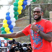 NBA All Star LeBron James holds an event at the Boys & Girls Club of Central Florida on Saturday, Feb. 25, 2012 in Orlando, Florida. The LeBron James Family Foundation and Sprite donated sporting equipment and introduced a new baseball diamond, renovated play area and a picnic area.  (AP Photo/Alex Menendez)