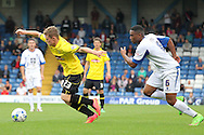 Burton Albion's Matty Palmer battles for the ball with Bury's Kelvin Etuhu. Skybet football league two match, Bury v Burton Albion at the JD Stadium, Gigg Lane in Bury, Lancs on Saturday 20th Sept 2014.<br /> pic by David Richards,  Andrew Orchard sports photography.