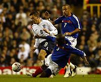Photo: Chris Ratcliffe.<br /> England v France. U21 European Championships.<br /> 11/11/2005.<br /> Darren Ambrose gets in between Jean Michel Badiane left and Julien Faubert