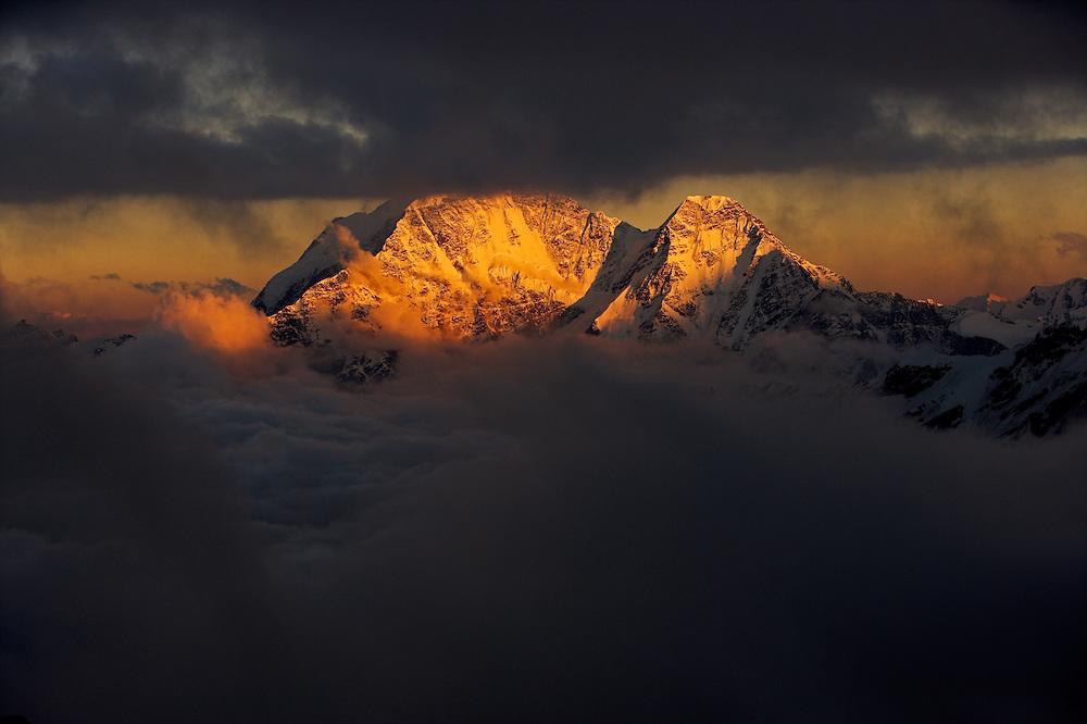 Russia, Caucasus, last light on Mount Donguzorun (4468 m asl), seen from Elbrus.