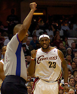PHOTO BY DAVID RICHARD.LeBron James pumps his fist as a foul is called after James made a layup in traffic yesterday against Washington.