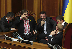 Dozens of opposition members surround the speaker s rostrum in Ukraine s parliament on April 2, 2013, as the parliament failed to set the date for Kiev mayoral elections. Only 209 deputies voted for a respective draft resolution, with at least 226 votes required. Early today, over 5,000 led by Ukrainian political opposition leaders Vitaly Klitschko, Oleg Tyagnybok and Arseny Yatsenyuk rallied outside Ukrainian parliament on Tuesday to press the lawmakers to schedule the date of new mayoral elections in Kiev, on April 2, 2013. Photo by Imago / i-Images...UK ONLY..