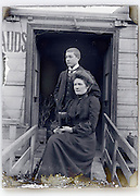 mother and son in front of houseboat door opening Paris early 1900s
