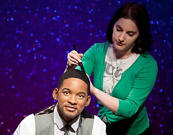 © Licensed to London News Pictures. 22/05/2013. London, UK. Wardrobe assistant, Luisa Compobassi adjusts the hair on a waxwork figure of rapper, actor and producer Will Smith after he was placed on a sofa alongside actor George Clooney and Harry Potter actress Emma Watson (not shown). The former Fresh Prince of Bel Air star today (22/05/2013) took his place in Madame Tussauds 'A-List' party in London. Photo credit: Matt Cetti-Roberts/LNP