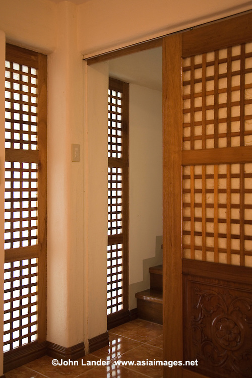 """Filipino doors and windows may resemble Japanese """"shoji"""" or sliding paper doors, but the ones in the Philippines are made of translucent shells rather than rice paper, as in Japan."""