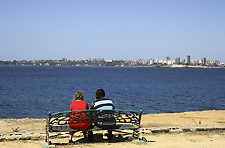 DAKAR, SENEGAL - FEBRUARY 28: A couple sits on a bench and watch the view at the Goree Island known as 'Island of Shame' due to its bad reputation in consequence of being a center of Atlantic slave trade between 15th to 19th century, in Dakar, Senegal on February 28, 2018. Island of Shame is now used as a museum to show colonialism and slavery activities of today's 'civilized' countries such as Portugal, Netherlands, England and France.<br /> <br /> <br /> <br /> <br /> <br /> <br />  Halil Sagirkaya / Anadolu Agency    BRAA20180308_112 Dakar Sénégal