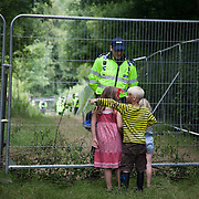 Children debate with a police officer guarding the Cuadrilla frack site. Thousands turned out for a march of solidarity against fracking in Balcombe. The village Balcombe in Sussex is the  centre of fracking by the company Cuadrilla. The march saw anti-fracking movements from the Lancashire and the North, Wales and other communities around the UK under threat of gas and oil exploration by fracking.