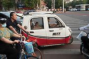 Electric battery powered covered motor tricycle<br /><br />Electric vehicles are everywhere on China's roads, from battery powered pedal bikes to hybrid cars, electric buses and all types of service vehicles.