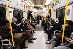© Licensed to London News Pictures. 17/03/2020. London, UK. Commuters travel on an underground train during the morning rush hour to emptier trains during the Coronavirus outbreak. Photo credit: Ray Tang/LNP