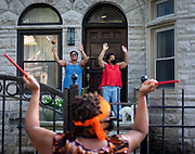 Yakini Ajanaku (center) gets her neighbors dancing while she and Jean Paul Coffy perform their nightly front porch concert for neighbors and friends Thursday, July 2, 2020 in Kenwood. (Brian Cassella/Chicago Tribune)