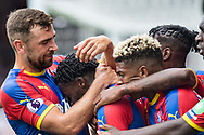 Jeffrey Schlupp (15) of Crystal Palace, celebrates after scoring goal with Patrick van Aanholt (3) of Crystal Palace, James McArthur (18) of Crystal Palace during the Premier League match between Fulham and Crystal Palace at Craven Cottage, London, England on 11 August 2018.