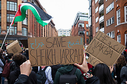Protesters hold signs and a Palestinian flag at a Free Palestine SOS Colombia rally in solidarity with the Palestinian and Colombian peoples outside the Colombian embassy on 15th May 2021 in London, United Kingdom. Speakers at the event, which took place on Nakba Day and also included a march to the Israeli embassy, highlighted human rights abuses being directed against Palestinians in Israel and the Occupied Territories, in particular attempts at forced displacements in Sheikh Jarrah in East Jerusalem, and also in Colombia, where peaceful demonstrators and human rights defenders have been killed and subjected to repression, detention and torture.