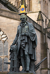 Edinburgh, Scotland, UK. 18 March 2020.Traffic cone placed on statue of Adam Smith on the Royal Mile in Edinburgh. Iain Masterton/Alamy Live News.