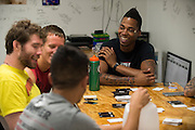 Fighters relax and play cards in the dorm after two classes and private workouts at Jackson Wink MMA in Albuquerque, New Mexico on June 9, 2016.
