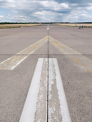 Old runway markings at new city public Tempelhofer Park on site of famous former Tempelhof Airport in Berlin Germany