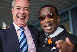 © Licensed to London News Pictures . FILE PICTURE DATED 27/09/2014 of NIGEL FARAGE with WINSTON McKENZIE at the UKIP Conference in Doncaster . Today (3rd November 2015) Winston McKenzie has quit UKIP , alleging racism within the party . Photo credit : Joel Goodman/LNP