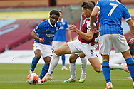 Brighton and Hove Albion defender Tariq Lamptey (2) is tackled by James Tarkowski of Burnley (5)   during the Premier League match between Burnley and Brighton and Hove Albion at Turf Moor, Burnley, England on 26 July 2020.