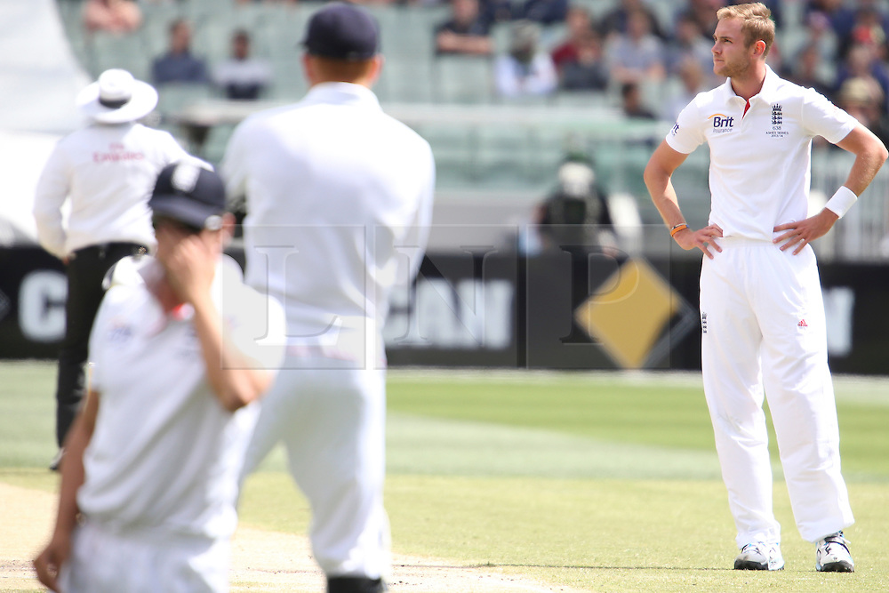© Licensed to London News Pictures. 29/12/2013. A disappointed Stuart Broad after captain Alastair Cook dropped another catch during Day 4 of the Ashes Boxing Day Test Match between Australia Vs England at the MCG on 29 December, 2013 in Melbourne, Australia. Photo credit : Asanka Brendon Ratnayake/LNP