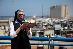 "© Licensed to London News Pictures. 16/08/2020. Beirut, Lebanon. Caritas Lebanon - an NGO based on the principles and values of the Catholic Church - hold a mass, titled ""Beirut Will Rise Again"", at Beirut port, following the huge explosion on 4 August. Photo credit : Tom Nicholson/LNP"