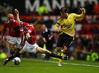 MANCHESTER, ENGLAND - MONDAY SEPTEMBER 20th 2004: Liverpool's Harry Kewell and Manchester United's Roy Keane during the Premiership match at Old Trafford. (Photo by David Rawcliffe/Propaganda)