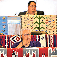 It took about four months for a green energy bill sponsored by Navajo Nation Council Delegate Elmer Begay, center, to reach the Navajo Nation Council during Day 2 of the Council's summer session Tuesday. But even with the testimonies of Tó Nizhóní Ání (Sacred Springs Speak) Executive Director Nicole Horseherder, left, and Navajo Government Development Director Edward Dee, right, the Council voted to send Begay's bill back to the Council's Resources and Development Committee Wednesday.