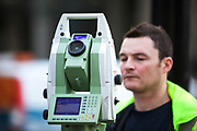 Surveyor operating a theodolite. A theodolite is a precision instrument for measuring angles in the horizontal and vertical planes. Theodolites are mainly used for surveying applications.