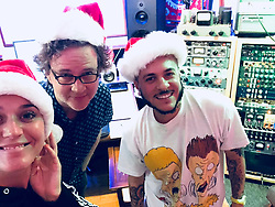 """Katy Perry releases a photo on Twitter with the following caption: """"""""#FBF to Christmas in September 🎅🏻🤶🏻 Setting a vibe in the studio with Santa's helpers @greg_wells and @ferras ❤ Have a great weekend, and don't forget to check out #CozyLittleChristmas 🎁 https://t.co/9Mi0Ej1ula 🎶"""""""". Photo Credit: Twitter *** No USA Distribution *** For Editorial Use Only *** Not to be Published in Books or Photo Books ***  Please note: Fees charged by the agency are for the agency's services only, and do not, nor are they intended to, convey to the user any ownership of Copyright or License in the material. The agency does not claim any ownership including but not limited to Copyright or License in the attached material. By publishing this material you expressly agree to indemnify and to hold the agency and its directors, shareholders and employees harmless from any loss, claims, damages, demands, expenses (including legal fees), or any causes of action or allegation against the agency arising out of or connected in any way with publication of the material."""