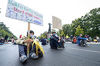 "25 SEP 2020, BERLIN/GERMANY:<br /> Junge Maenner mit Schild ""Build a better future! - Start right now"" und ""There is no Planet B"" vor der Plastik ""Der Rufer"", Fridays for Future Demonstration fuer Massnahmen gegen den Klimawandel, Brandenburger Tor, Strasse des 17. Juni<br /> IMAGE: 20200925-01-060<br /> KEYWORDS: Protest, Demonstrant, Demonstranten, Demonstratin, Schueler, Schüler, Klimakatastrophe, FFF, Mundschutz, Mund-Nase-Schutz, Abstand"