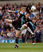 Photo. Glyn Thomas, Digitalsport.<br /> Blackburn Rovers v Leicester City. <br /> FA Barclaycard Premiership. 17/04/2004.<br /> Blackburn's John Stead (L) battles for the ball with Nikos Dabizas.