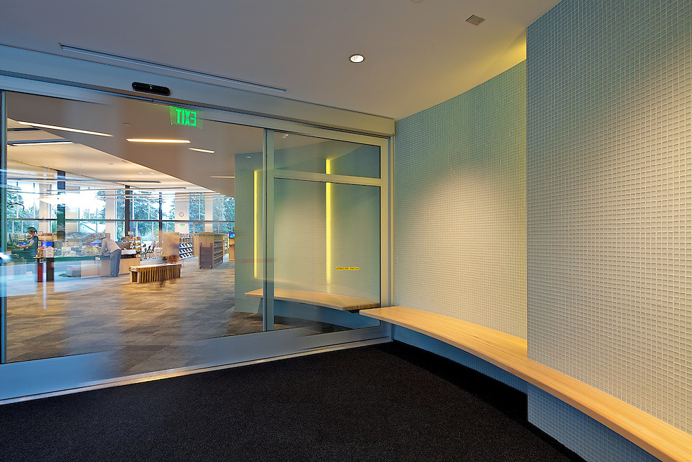 A shot in the curved entry, leading the viewer to the check out desk beyond.
