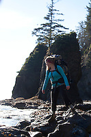 Young woman backpacking near Third Beach in Olympic National Park, WA