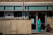 Medical personnel takes a brief rest outside the Scherr Legate Trauma Center at University Medical Center and El Paso Children's Hospital in El Paso, Texas, October 26, 2020. Hospitals in El Paso County have been overwhelmed with patients because of a surge in COVID-19 cases. (Joel Angel Juárez / The New York Times)