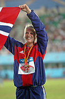Friidrett<br /> Junior-VM 2006<br /> Beijing Kina<br /> 20.08.2006<br /> Foto: Hasse Sjögren, Digitalsport<br /> NORWAY ONLY<br /> <br /> Premieutdeling sjukamp - Ida Marcussen