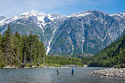 With Kimsquit Peak as a backdrop, fishing buddies Pat Bogdan and David Page share a fine piece of holding water near tidewater on BC's Dean River.