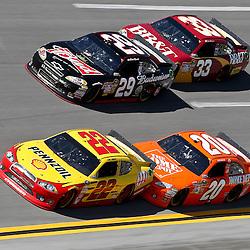 April 17, 2011; Talladega, AL, USA; NASCAR Sprint Cup Series driver Joey Logano (20) drafts Kurt Busch (22) and Clint Bowyer (33) drafts Kevin Harvick (29) during the Aarons 499 at Talladega Superspeedway.   Mandatory Credit: Derick E. Hingle